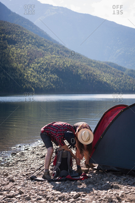 Couple setting up tent on a sunny day