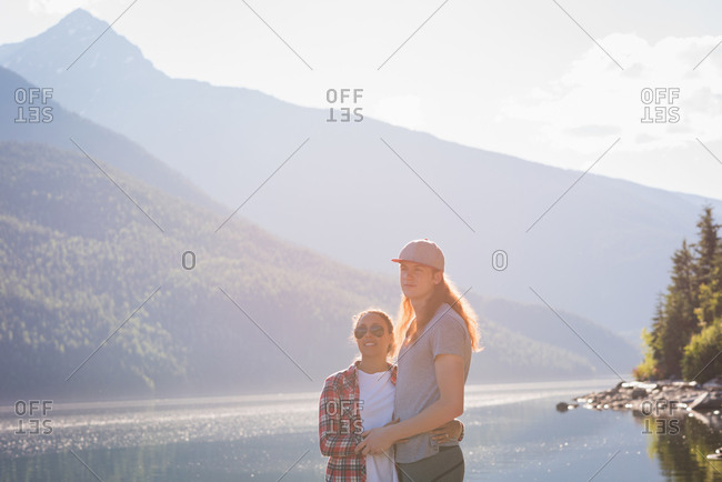 Couple standing near riverside at countryside
