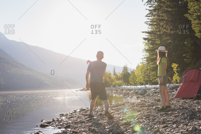 Couple having fun near riverside in countryside