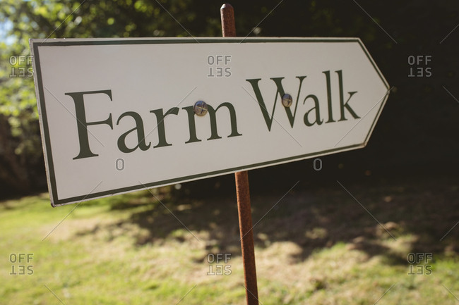 Close-up of signboard in the farm