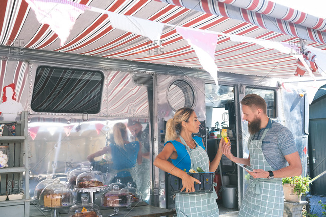 Couple interacting with each other near food truck