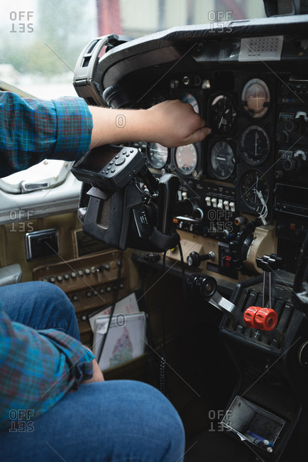 close-up of engineer operating cockpit