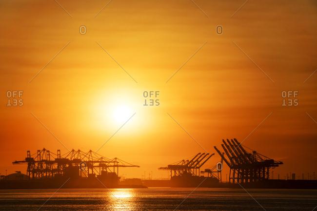 Sunrise over a metro port