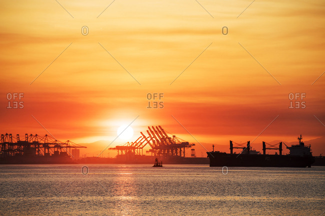San Pedro, CA - July 6, 2018: Sunrise over a metro port