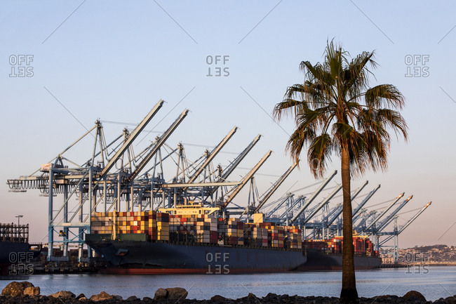 Container ship at loading area in port