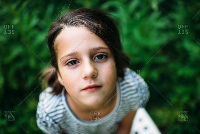 Portrait of a little girl outside in a yard