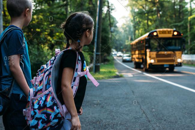 Children waiting for an approaching school bus