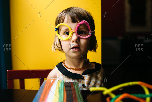 Little girl playing with pipe cleaners