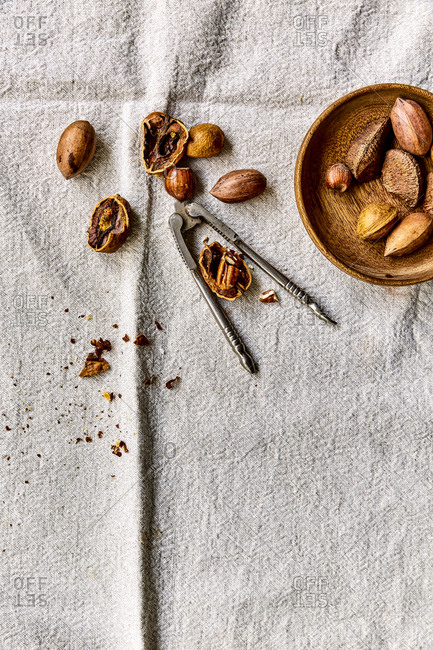 Hazelnuts, almonds and pecans on a linen tablecloth
