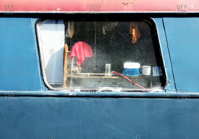 Looking through a dirty window in a bus