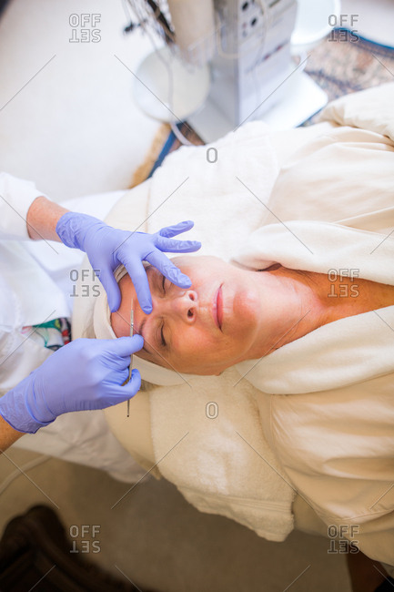 Woman receiving skincare treatment
