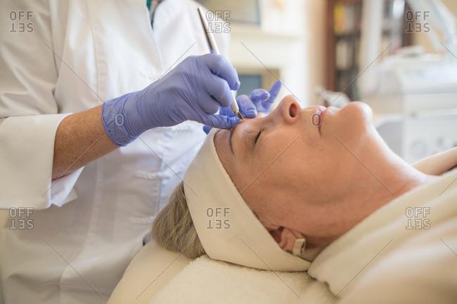 Woman receiving micro blading treatment