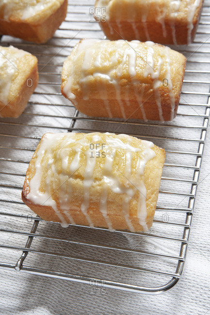 Mini Lemon Breads with Drizzled Icing on Cooling Rack
