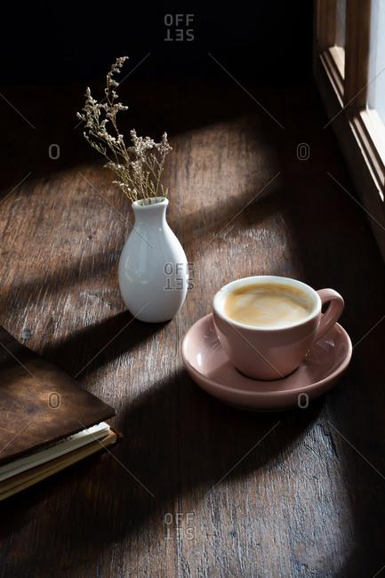 Espresso Drink Next to a Window