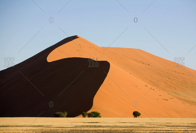Large sand dune surrounding the Deadvlei clay pan in Namib-Naukluft National Park