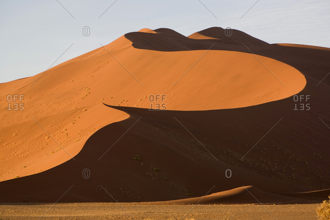 Enormous sand dune above the Deadvlei clay pan in Namib-Naukluft National Park