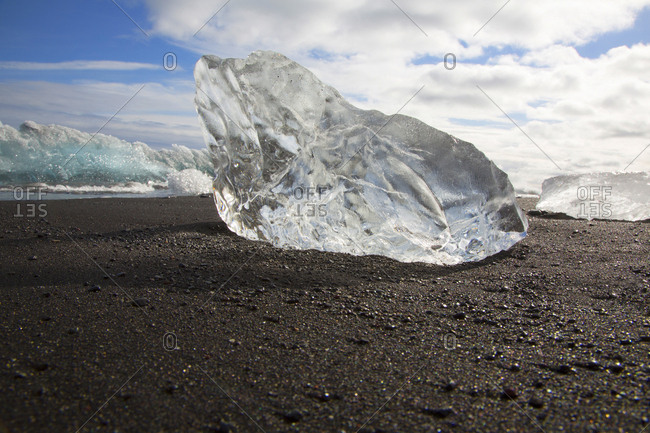 Large piece of glacier ice on beach in Iceland