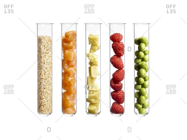 Foods in test tubes, studio shot.