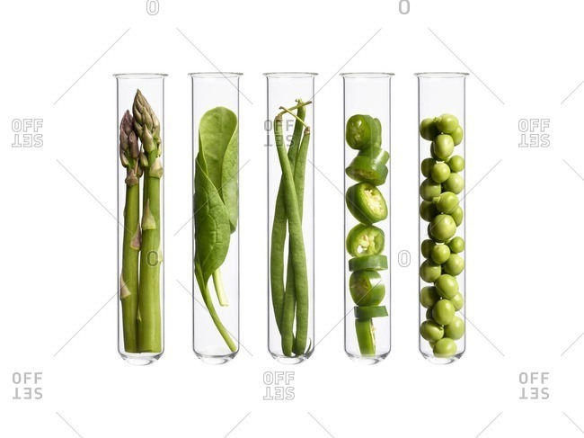 Vegetables in test tubes, studio shot.