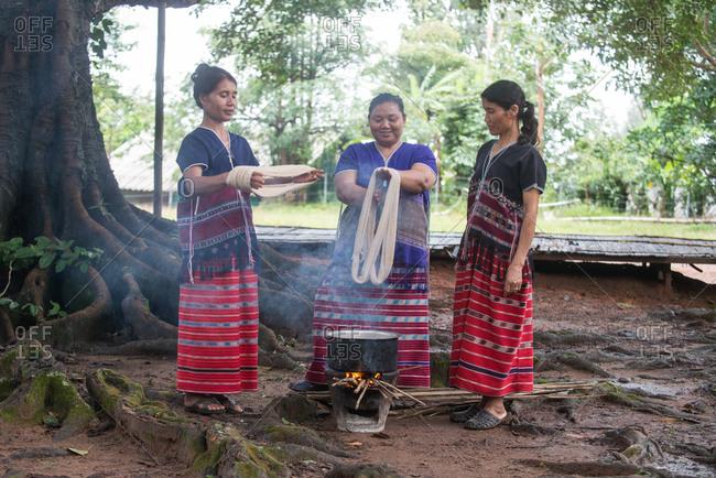 August 18, 2018: Asian Karen Hill Tribe Women Dyeing Fabric. Chiang Mai,  Thailand.