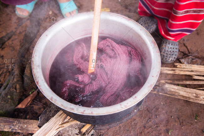 Close up on Asian Karen Hill Tribe Woman Dyeing Fabric