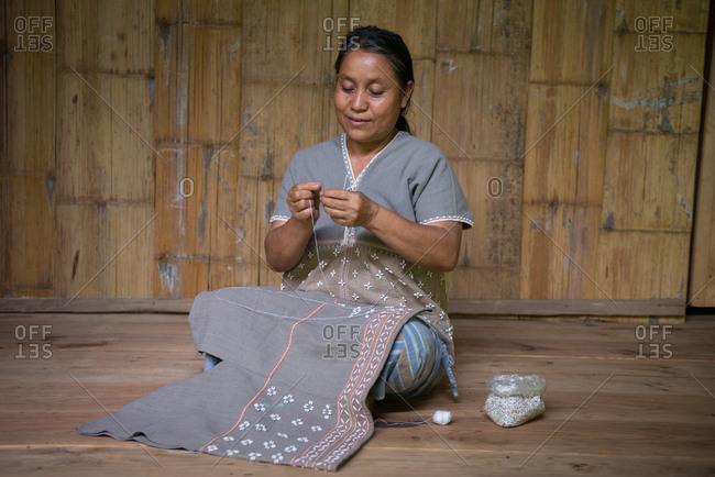 August 19, 2018: Karen Woman Knitting Traditional Cloths in Chiang Mai, Thailand.