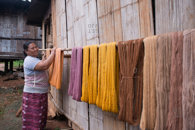 August 19, 2018: Asian Karen Hilltribe Woman Drying Dyed Fabric. Chiang Mai, Thailand.