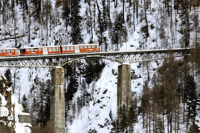 February 24, 2014: Switzerland, Canton of Vaud, Zermatt ski resort, Gornergrat railway on a viaduct