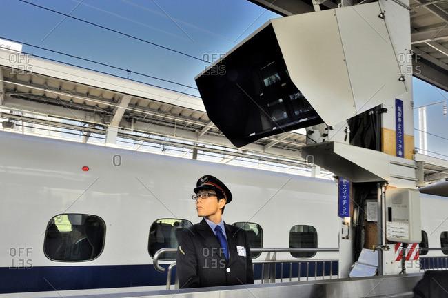 November 16, 2013: Japan, Okayama, station master of the Shinkansen high-speed railway line