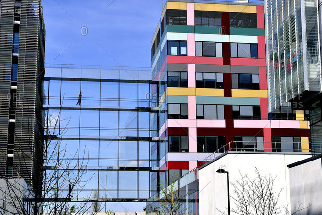 April 13, 2015: France, Paris, modern architecture near the boulevard Macdonald, coloured buildings, contemporary facades