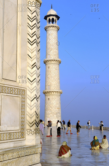 March 17, 2011: India, Agra, Indians at the foot of the Taj Mahal minaret