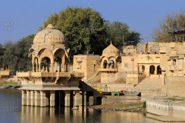 March 26, 2011: India, Rajasthan, Jaisalmer, ghats and standstone pavilions along the Gadhisar lake
