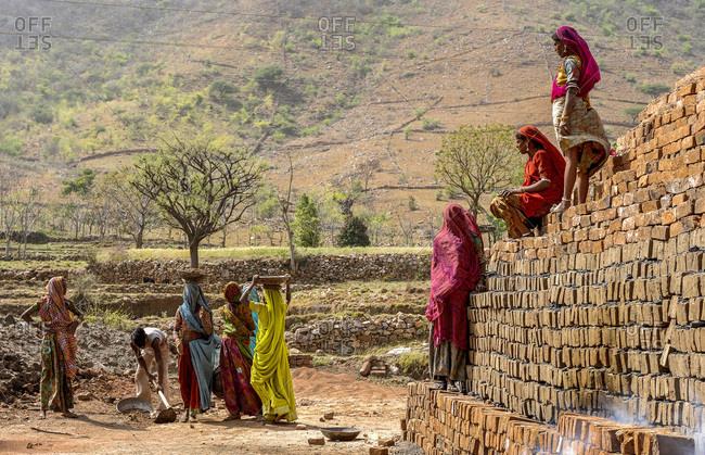 March 30, 2011: India, Rajasthan, Indian women in saris in an artisanal brickyard