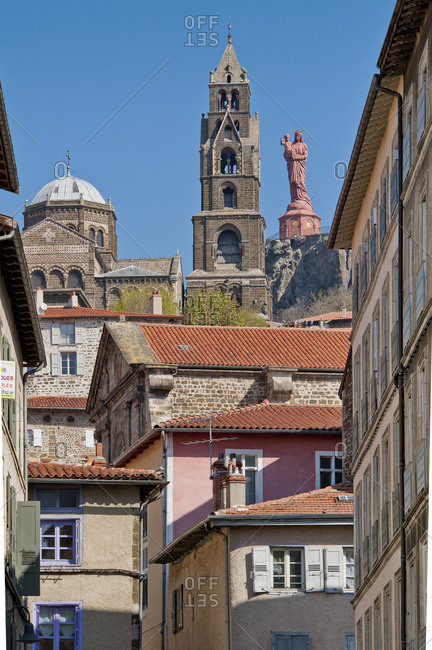 April 17, 2011: France, Auvergne-Rhones-Alpes, Haute-Loire, Le Puy-en-Velay, the cathedral and the statue of Notre-Dame-de-France above the College church