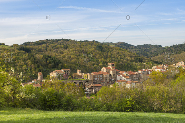 France, Auvergne-Rhones-Alpes, Haute-Loire, a 12th century collegiate church overlooking the medieval city of Auzon, built on a crest