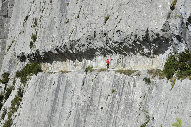 Atlantic pirineas, Bearn, Etsaut,the mast way, a man is hiking on a path dug into the rock