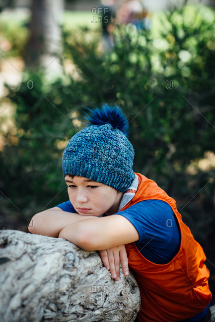 Portrait of a young boy wearing a blue knit hat