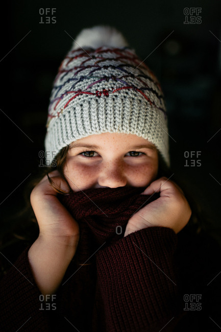 Portrait of a young girl wearing knit hat and sweater