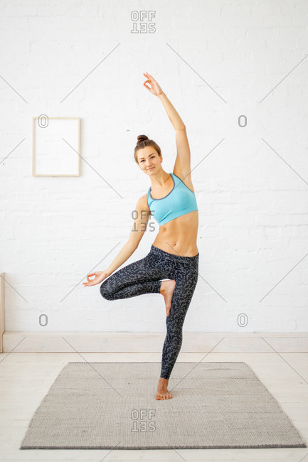 Woman doing standing yoga pose