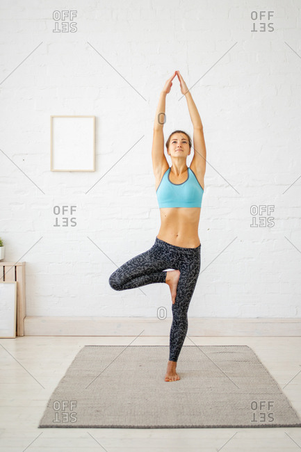 Young woman doing tree pose