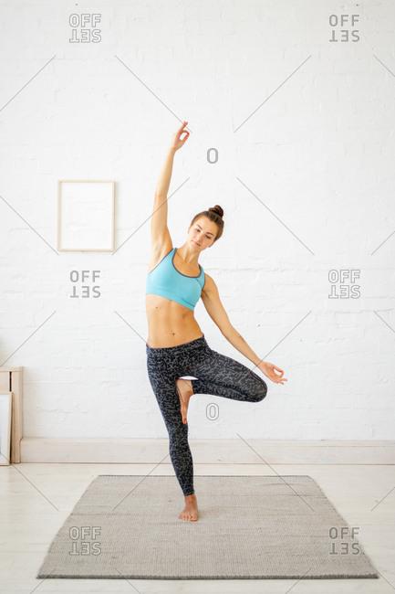 Woman doing standing yoga poses