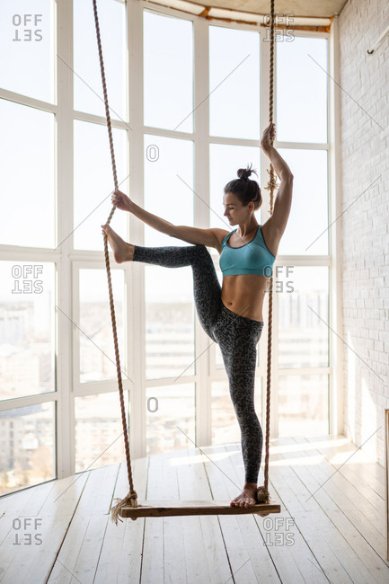 Woman working out on swing