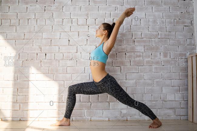 Woman doing warrior yoga pose