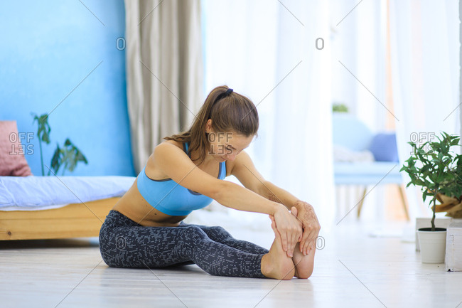 Woman stretching on floor