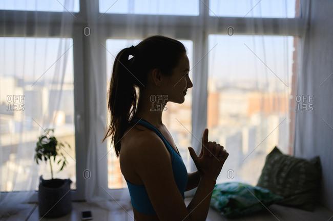 Silhouette of woman doing yoga pose