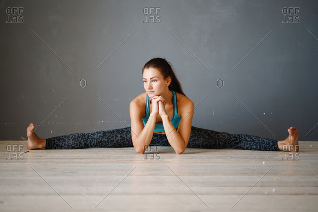 Young woman stretching on floor during workout
