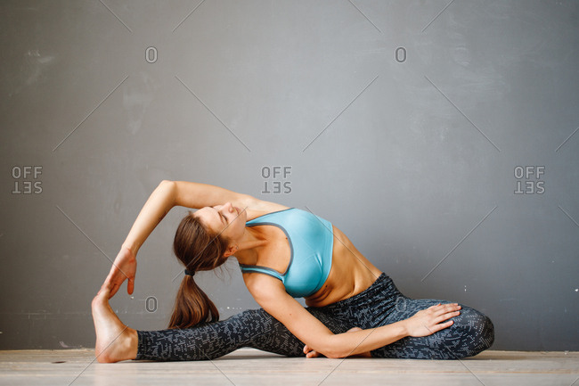 Young women doing stretches on floor