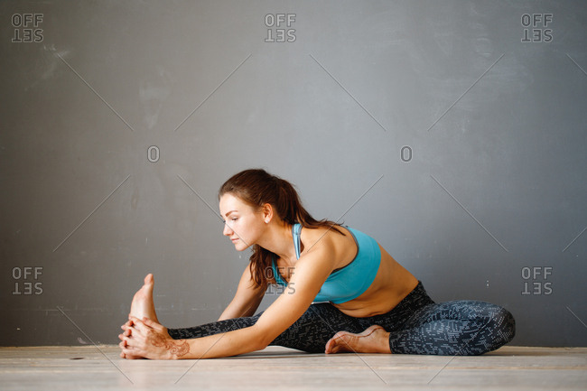 Woman doing stretches on floor