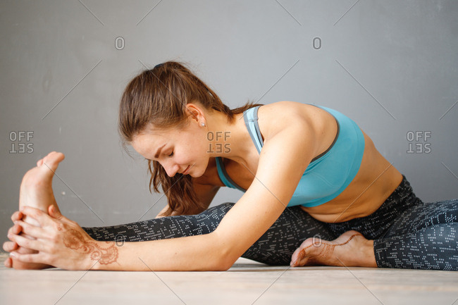 Close up of woman doing stretches on floor