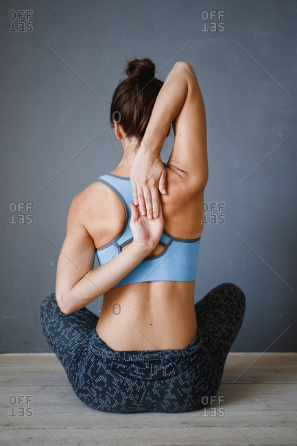 Rear view of woman doing yoga stretches